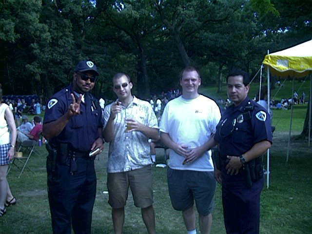 Chris and Bri chillin' with cops at Beer Fest 2000